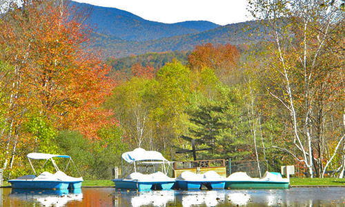 Boats and White Mountains in background