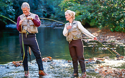 Retired couple having fun fly fishing at Lost River